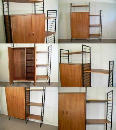 A teak Ladderax system featuring the rare wardrobe module with slide out hanging rail and shelves to the interior. An original Staples system from the 1960s