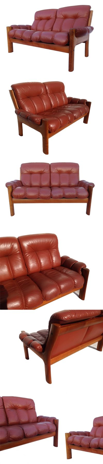 A  teak and leather 2 seater sofa by Glostrup mobelfabrik of Denmark, c1970s. One of a pair available.