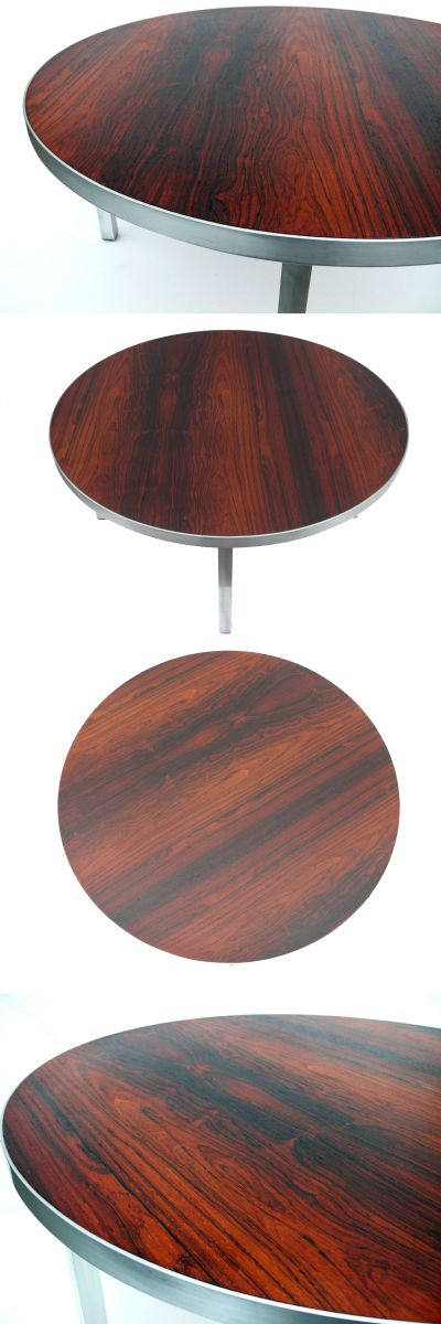 A rosewood coffee table, c1970s standing on an aluminium base