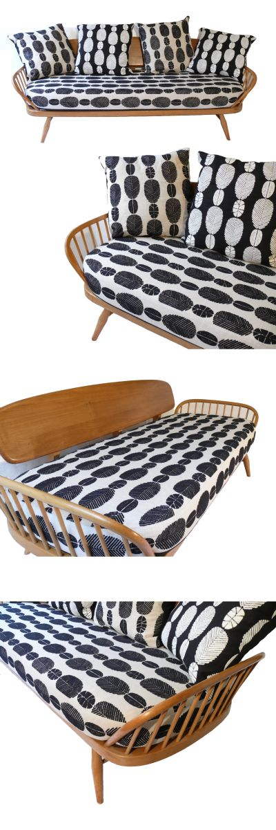 An Ercol model number 355 studio couch/daybed. Solid beech and Elm c1960s. Newly upholstered in Majani Safi by Warwick fabric