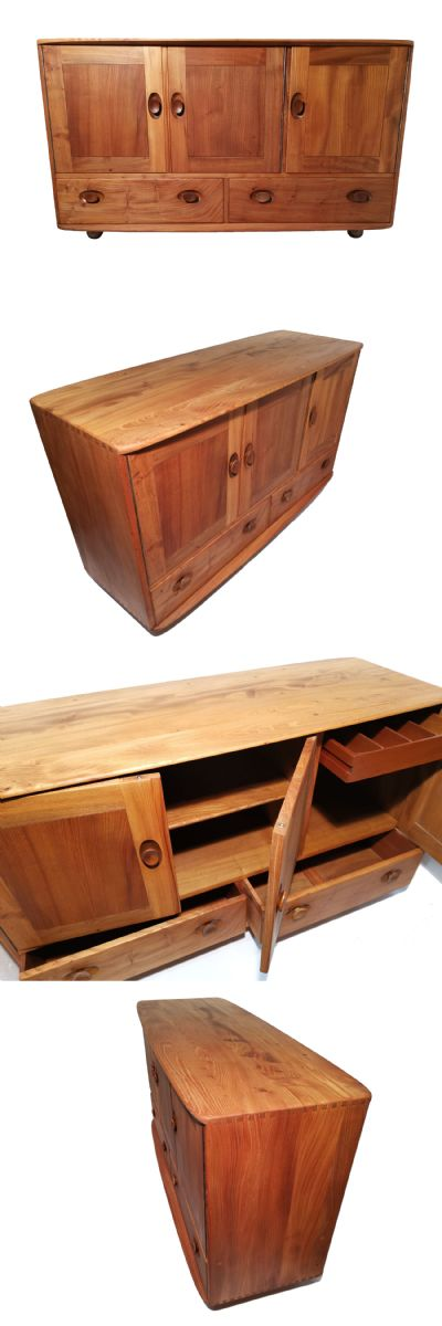 An early Ercol Windsor sideboard model number 429. In solid Elm complete with cutlery drawer.