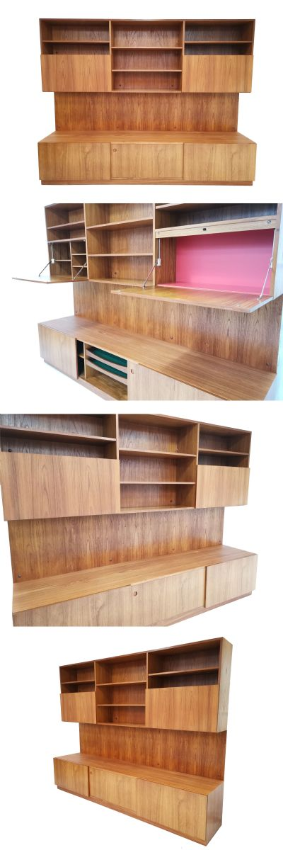A large Teak bookcase/Cabinet model number SK38 designed by Reno Wahl Iversen for Mobel Fakta of Denmark. Often mistakenly attributed to IB Kofod Larsen, the original label is present.