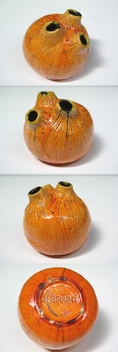 A glazed vase, c1970s. Designed by Juliette F. Belarti. Of circular organic form with three finials and a wonderful textured finish. More commonly known for her tileware, this is an excellent example of her work