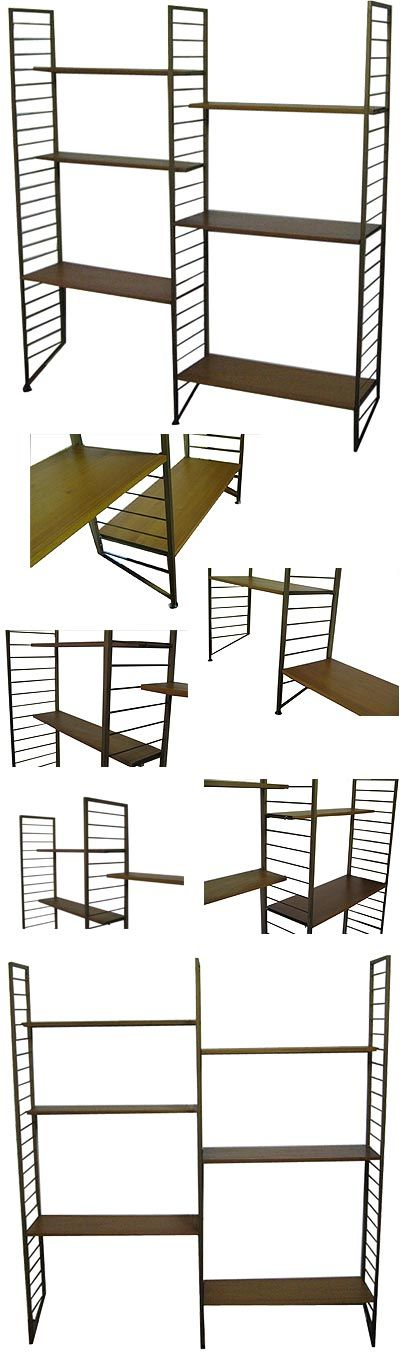 A two bay Ladderax shelving system. Metal uprights with teak shelves.