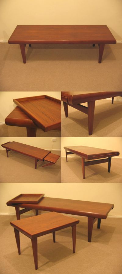 A teak coffee table, made in Denmark c1970s. A highly unusual table, with a matching smaller table and draw/tray, that both slide out of opposing end sections. Charming and rare.